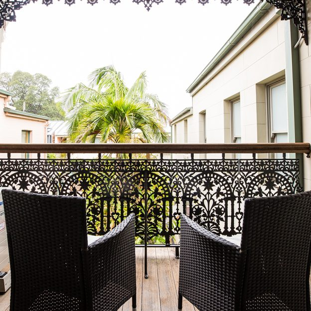 high quality synthetic rattan chairs in the balcony of our suites at Avonmore on the Park