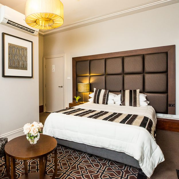 King bed and high-quality furnishings with opulent, expensive touches adorns the king suite at Avonmore on the Park