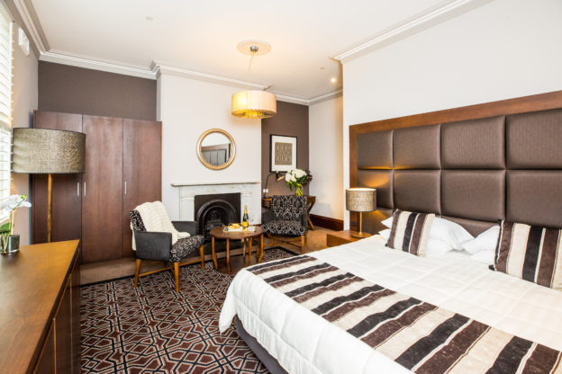 inside Avonmore on the Park's king suite which features a comfortable king size bed and luxury furnitures