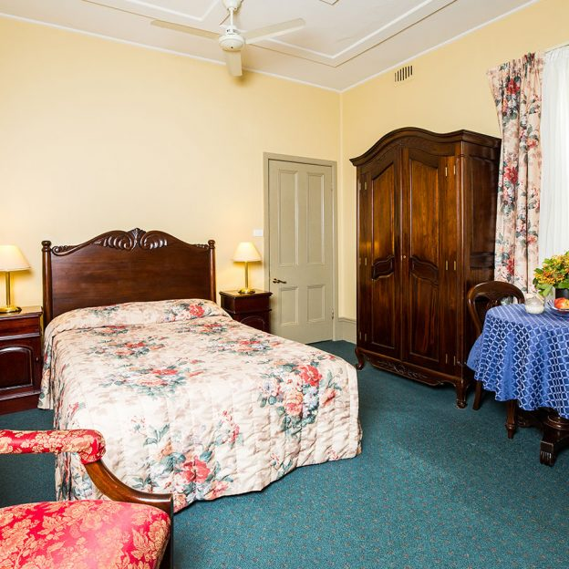 twin bed with good mattress and high-quality sheets in Avonmore on the Park Randwick accommodation